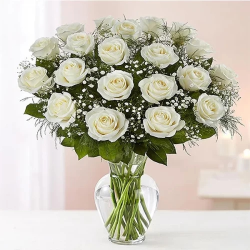 white rose with glass vase