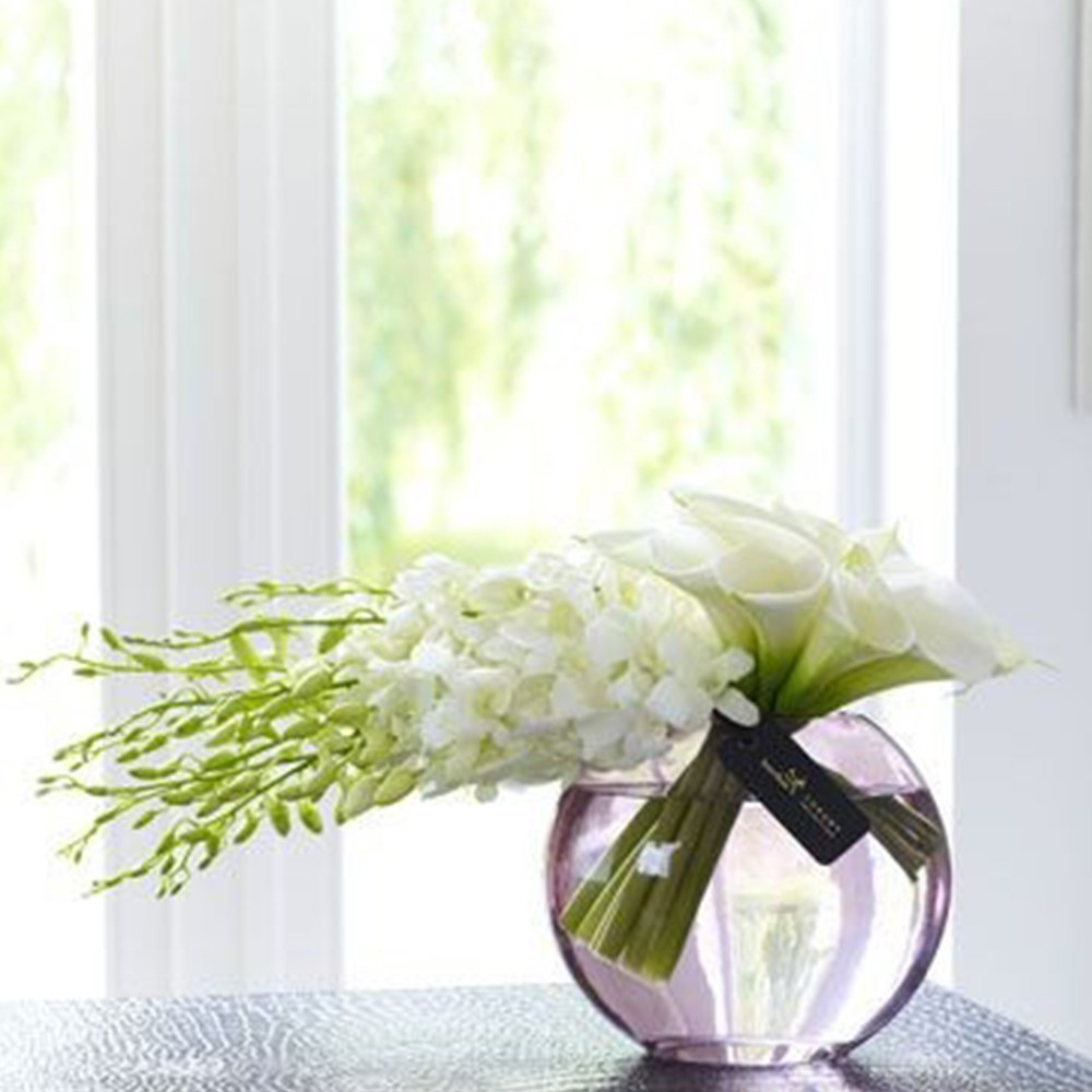 10pc white orchid 10pc calla lily with a glass vase arrangement