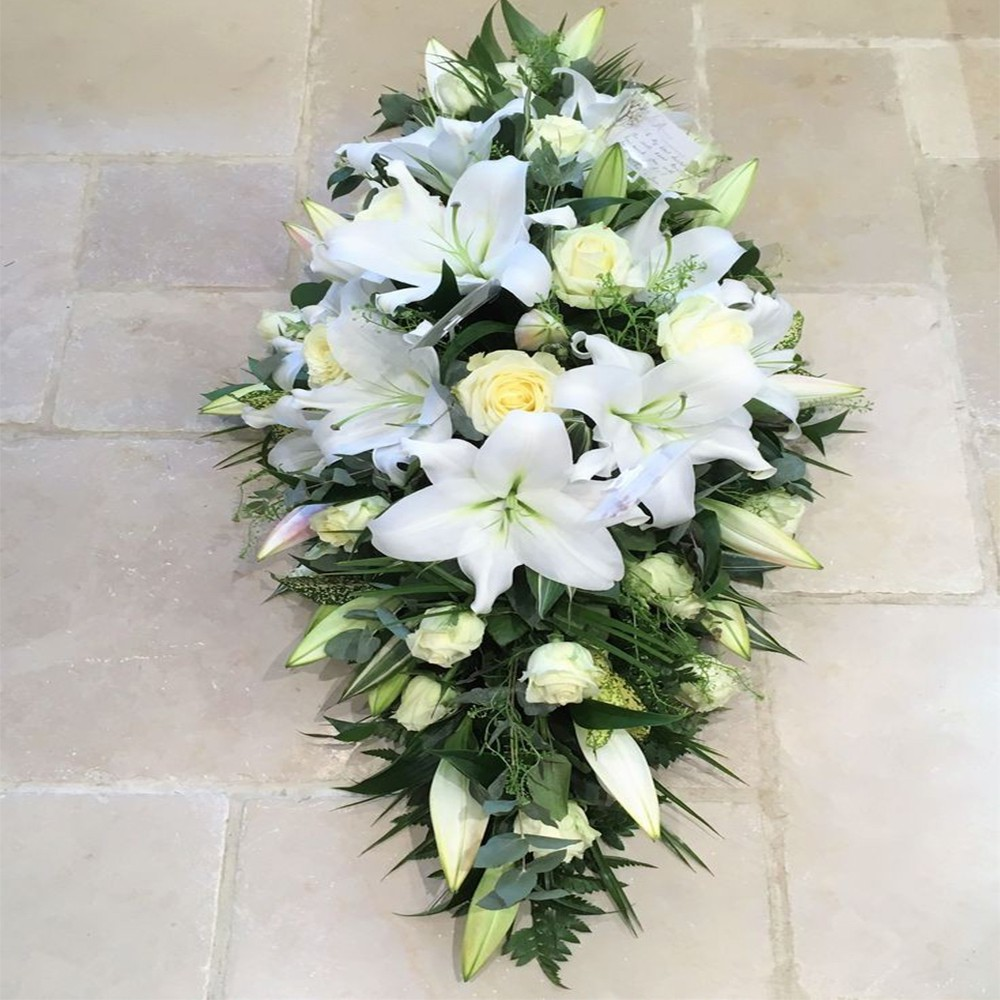 3 Ft Long and Low White Lily's, White Rose, White Chrysanthemum.