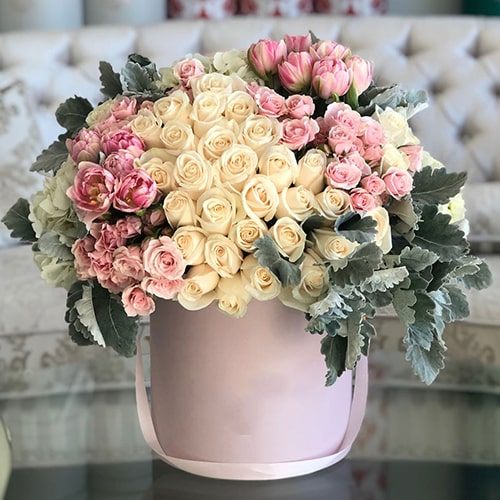 Charming flower arrangement with box