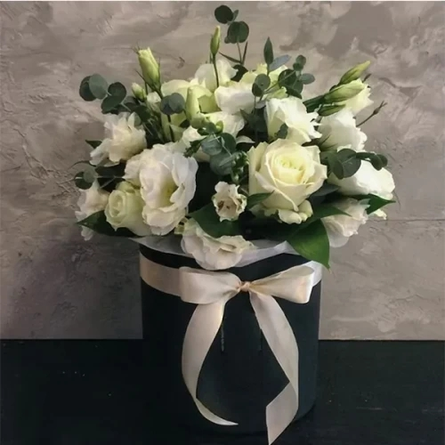 all white flower arrangement with box