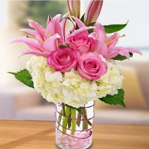 2 white hydrangea pink rose 1 pink Lily's