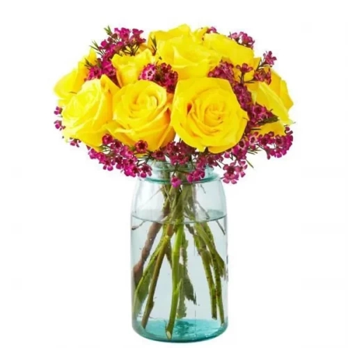 15 yellow rose with pink wax flower in a glass vase