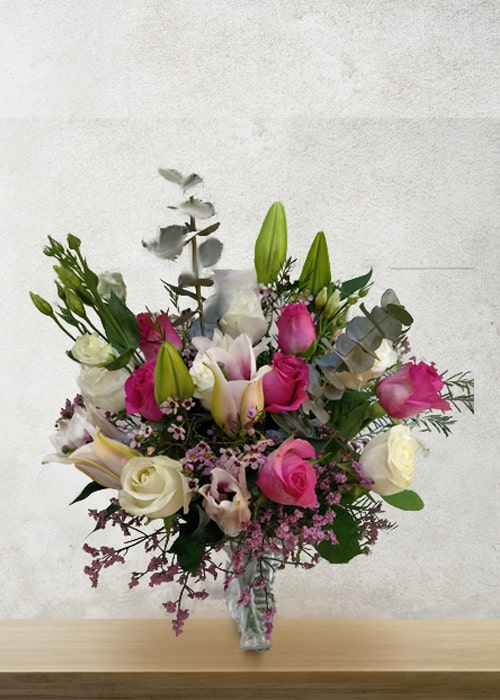 Pink Lilly and white rose arrangements