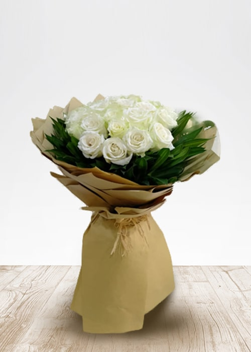 30 white rose bouquet with green leafs