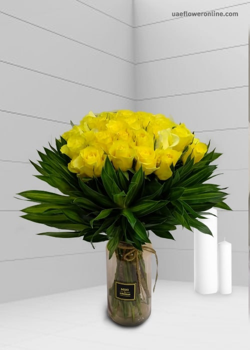 Sunshine Yellow rose in a glass vase