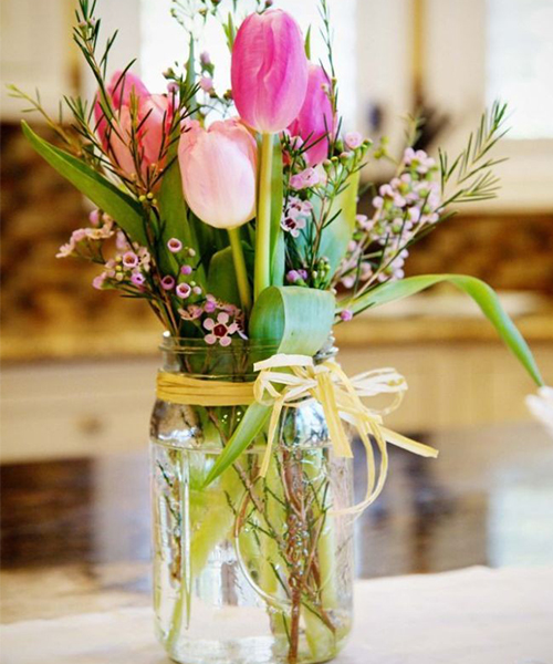 10 stem pink tulip with pink waxflower with glass vase