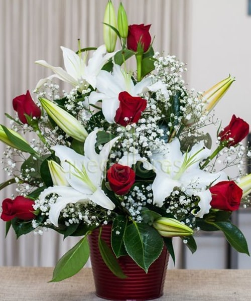 Arrangement of 7 red rose 9 white Lily with gypsophilia