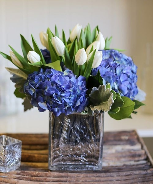 Hydrangea and tulip in a glass vase