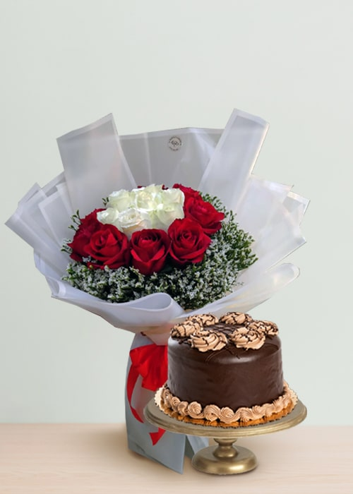 white and red rose bouquet with chocolate cake