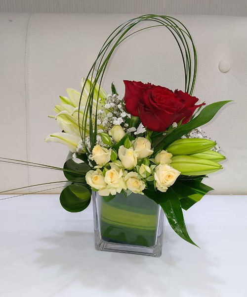Dazlink lily and rose with glass arrangement