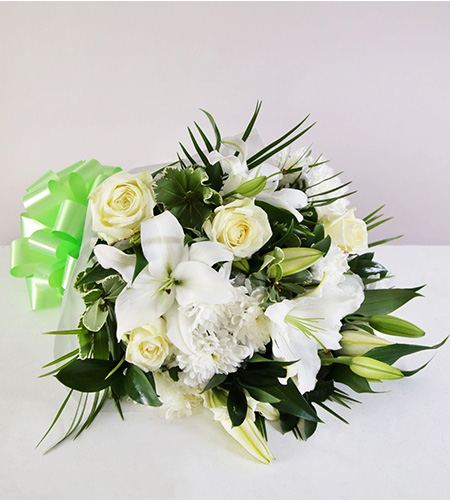 White lily and rose funeral arrangement