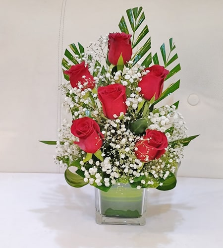 Love Arrangement in a vase with green leaves