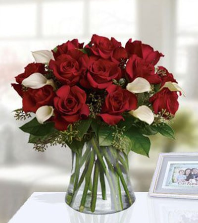 Wildly Romantic roses with glass vase