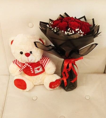 Red rose with soft teddy bear
