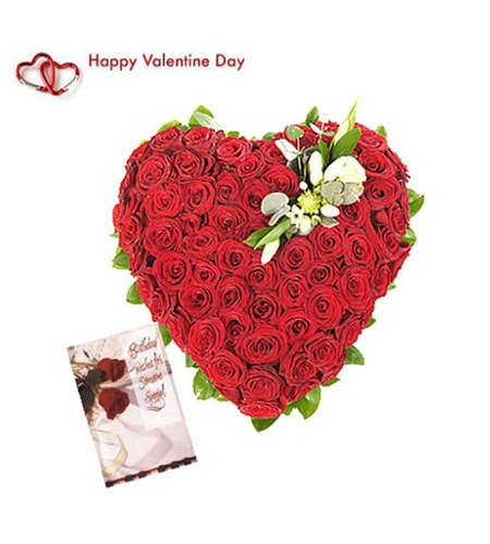 Heart shaped roses arrangement with card