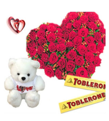 Heart shaped roses arrangement with teddy and chocolates