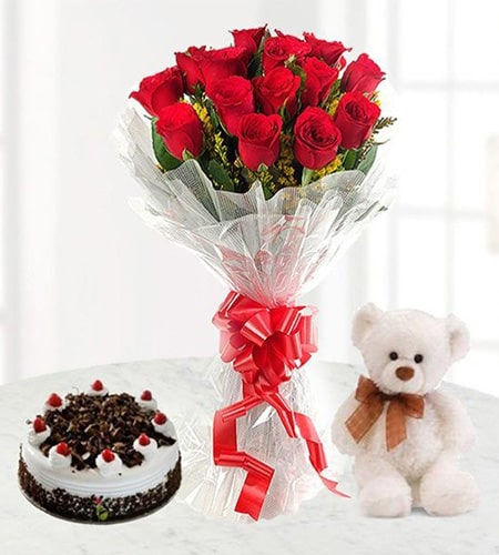 Superb 10 roses and teddy with chocolates cake