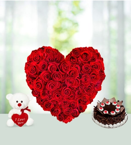 Graceful heart shape roses with cake and teddy