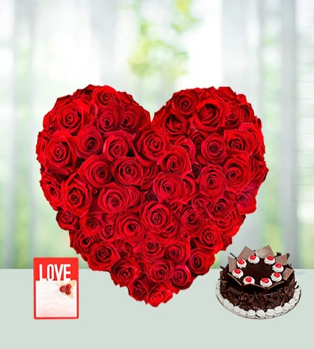 Charming red roses heart shape arrangement with chocolates cake